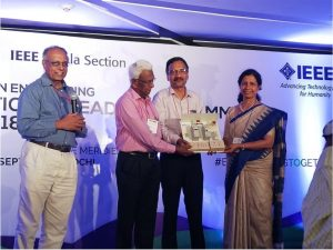 Director, Dr. Mini Shaji Thomas handing over the Electricity board to IEEE Kerala Section Chair Prof. Sameer